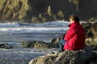 A woman enjoys a quiet moment during a vacation on the Olympic Peninsula in Washington, USA.