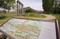 An information sign displaying a map of the Monte St Maxime which rises behind the Roman columns in Riez, Provence in France.