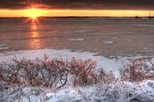 photo of Arctic Lake Ice Sunset