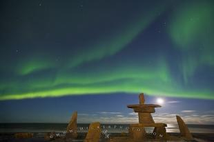 photo of Aurora Borealis Inukshuk Moon Churchill Hudson Bay Manitoba