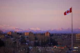 photo of Calgary Rocky Mountain Sunset with Canadian Flag