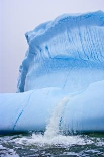 photo of Global Warming Melting Iceberg Pouring Water