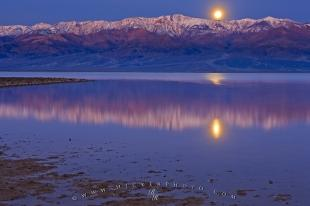 photo of Moonrise Reflections Badwater Basin Death Valley