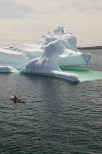 photo of kayaking with icebergs