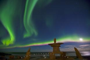 photo of Northern Lights Dancing In The Moon Light Inukshuk Hudson Bay