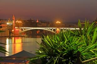 photo of Puente De Isabel II Bridge Rio Guadalquivir Dusk Seville Andalusia Spain