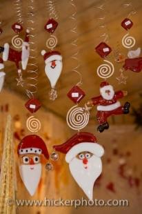 photo of Santa Hanging Christmas Ornaments