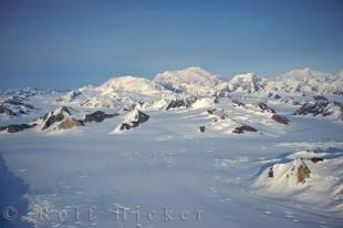 photo of Snow Covered Rock Formations Mountainous Landscape Yukon