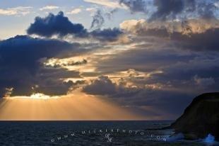 photo of Storm Clouds Sunset Sun Beams Ocean