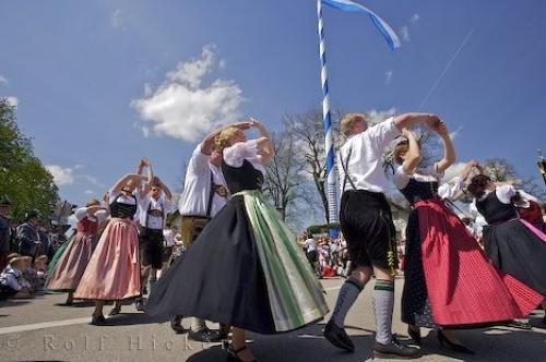 A group of people dancing during the Maibaumfest in Putzbrunn, Germany.