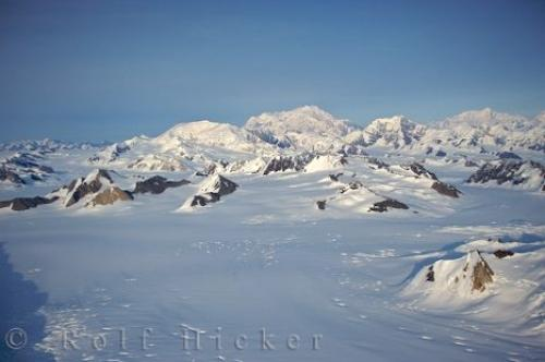 Photo:  Snow Covered Rock Formations Mountainous Landscape Yukon