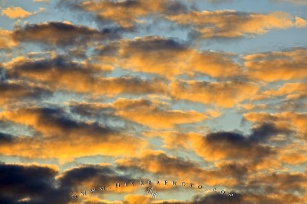 Photo:  Puffy Sunset Clouds Free Wallpaper Background