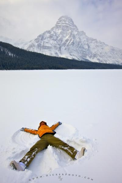 Photo:  Tourist Making Snow Angel Winter Scenery