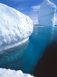 picture of blue ice underwater of iceberg