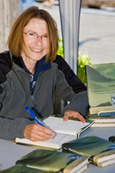 photo of Cathy Converse book signing at Telegraph Cove on Vancouver Island in British Columbia