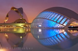 Picture of the amazing architecture of the Palau des les Arts Reina Sofia and LHemisferic in the City of the Arts complex lit up at night in the city of Valencia Spain