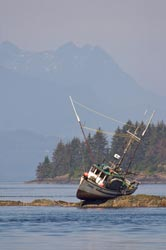 photo of a boat on a rock along the British Columbia coastline