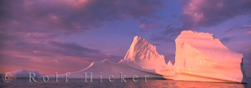 panoramic photo of an iceberg at sunset