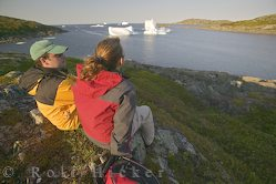 picture of a young couple watching an iceberg